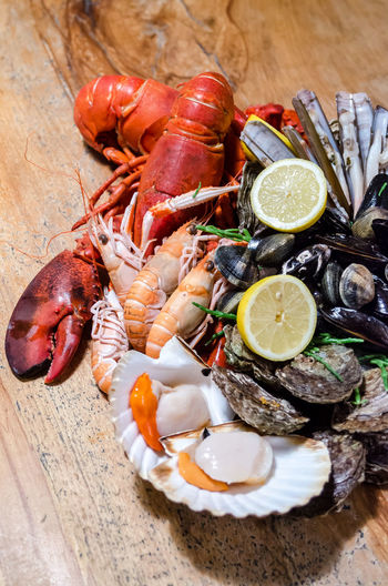 Lobster Meal Crustacean Food Food And Drink Foodphotography Freshness Garnish Gourmet Healthy Eating Indoors  Luxury No People Organic Plate Raw Food Ready-to-eat Scallop Seafood Shell Table Tabletop Wellbeing Wood - Material Yummy