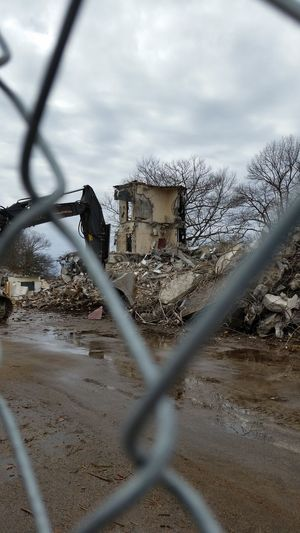 Remains of building at former Naval Air Station, South Weymouth (Massachusetts) Fence Chainlink Fence Sky Cloud - Sky Metal No People Outdoors Day Close-up Destruction Demolition Demolished Demolition Zone