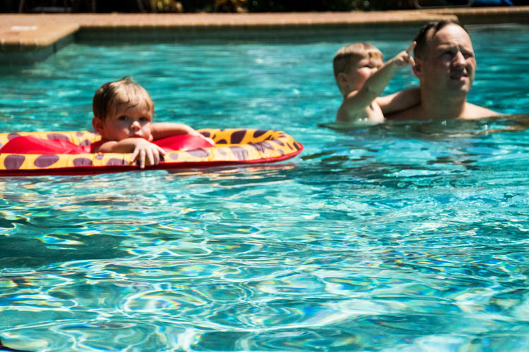 Baby Swimming Bonding Boy With Father Childhood Enjoyment Family Fatherhood  Fatherhood Moments Floating Fun Holding Innocence Lifestyles Summer Swimming Togetherness Vintage Look Vintage Photo Water Live For The Story