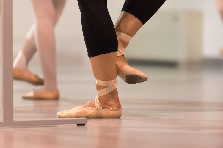 Low Section Of Ballerinas Practicing In Studio