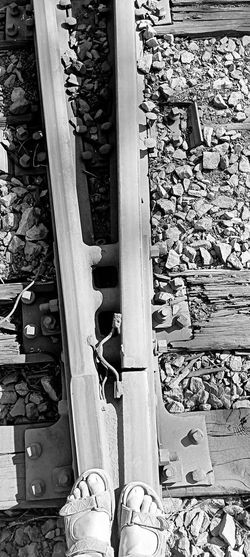 Low section of man standing on railroad track