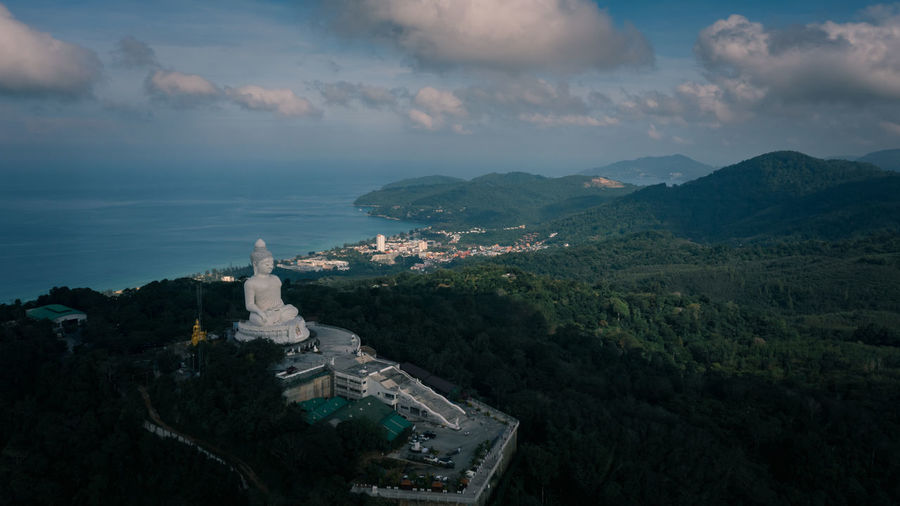 Big white buddha statue on top of mountain view point and landmark destination in phuket province