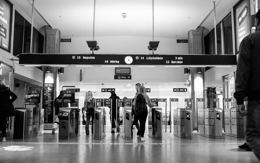 Interior of Östermalmstorg metro station in Stockholm Illuminated Communication Architecture Walking Real People Subway Station Built Structure Sign Women People Lifestyles Ceiling Tiled Floor Transportation Indoors  Text Metro Station Metro City Life Streetphotography Streetphoto_bw