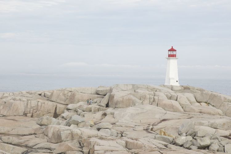Boulders In Foreground Light Lighthouse At Dawn Lighthouse In The Distance Lighthouse Photography Lighthouse_captures Peggy's Cove Red And White Lighthouse Tower Tranquil Scene Copy Space