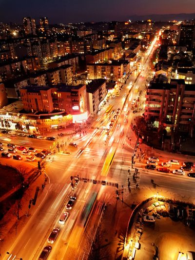City Cityscape Illuminated Road Aerial View Car Land Vehicle High Angle View Street Traffic Two Lane Highway Highway Multiple Lane Highway Light Trail Road Intersection Viaduct Light Painting High Street Headlight Urban Road Semi-truck Dividing Line Crossroad Tail Light Traffic Jam Streetwise Photography