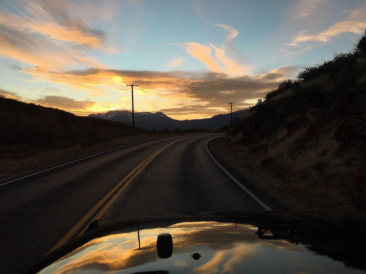 transportation, sky, sunset, cloud - sky, road, land vehicle, no people, car, mode of transportation, the way forward, nature, motor vehicle, direction, diminishing perspective, windshield, beauty in nature, transparent, scenics - nature, vehicle interior, glass - material, outdoors, car point of view, road trip