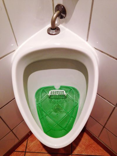 High angle view of urinal in public building