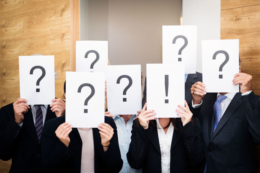 Business Doubt Icon Office Teamwork Text Business Person Businessman Businesswear Businesswoman Caucasian Concept Group Group Of People Group Shot Indoors  Men People Portrait Professional Question Question Mark Team Togetherness Women