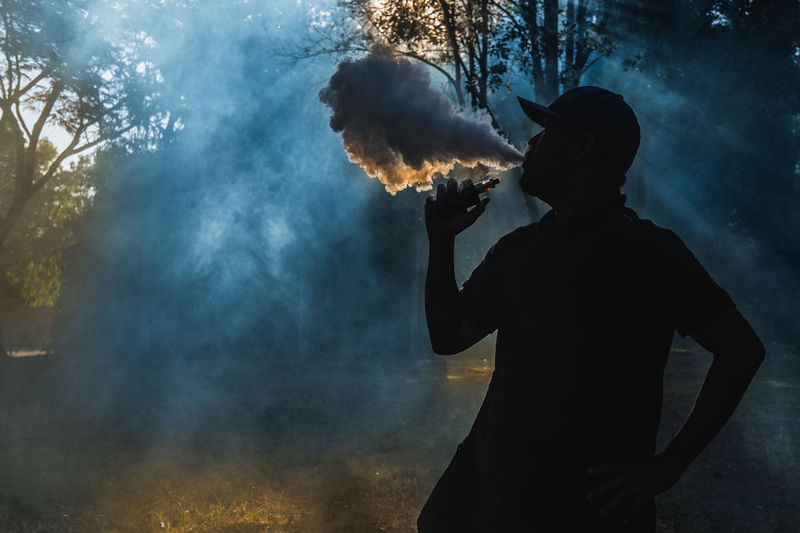 Ambient Light Dark Facinating Morning Morning Light My Way Of Life Nature Silhouette Vaping Way Of Life Blue Darkness And Light Day Lifestyles Men Nature One Person Outdoors People Pollution Real People Silhouette Smoke - Physical Structure Vape Yellow