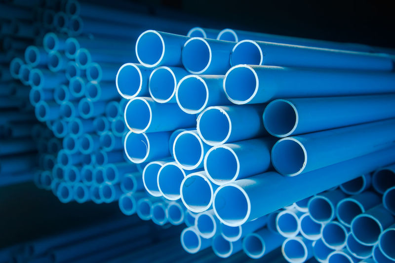 Stack of blue plastic pipes