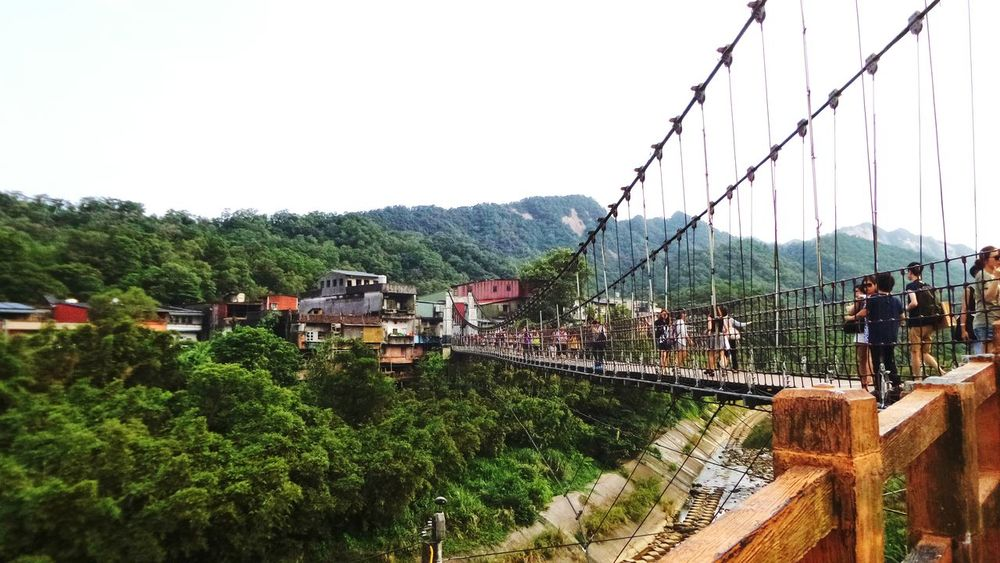 Crossing the suspension bridge at Shifen, Taiwan. 新北市平溪区十分站,过吊桥。 Bridge Suspension Bridge Taiwan Shifen Village Tourist Being A Tourist Tourists Holiday