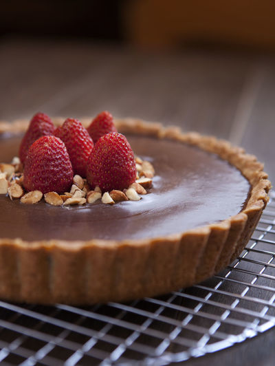 Chocolate tart on cooling rack