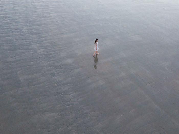 High angle view of woman walking on beach