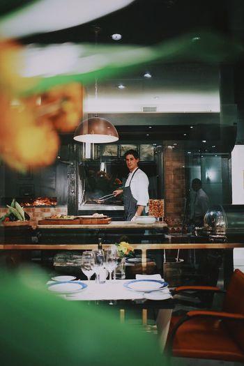 Portrait Of Chef Preparing Food In Restaurant