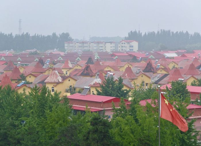 Scenic view of residential district against clear sky