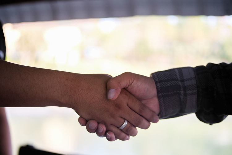 Cropped Image Of Friends Shaking Hands