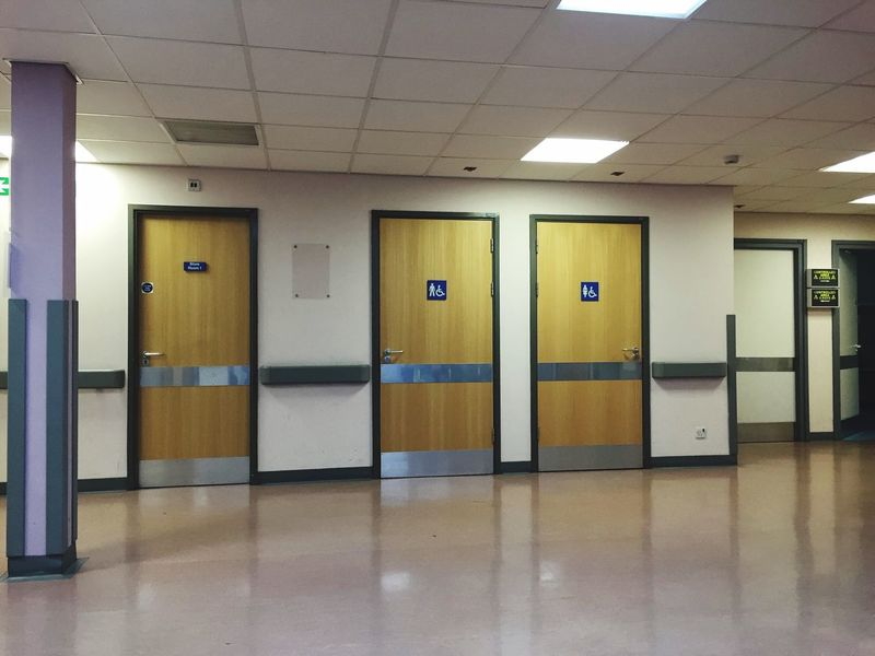 Welcome to X-Ray. Hospital Toilets Empty Places Hospital Corridor Waiting Room Xray X-Ray Sign Souless Toilet Doors Lights Reflective Floor