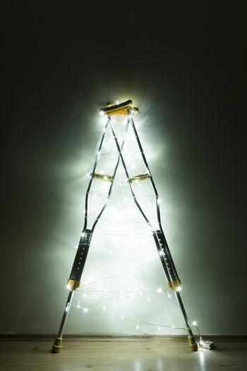 Close-up of illuminated string lights in darkroom