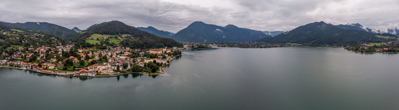 Drone shot over tegernsee outside munich showing lake and mountains.