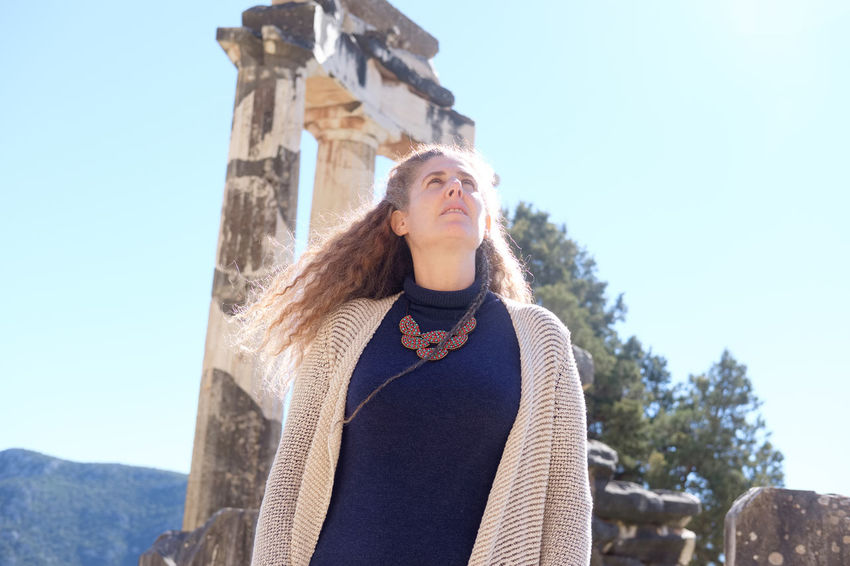 feel the peace in ancient Delphi with Raphaela Gilla One Person Lifestyles Sky Front View Leisure Activity Architecture Standing Nature Real People Low Angle View Waist Up Day Young Women Casual Clothing Young Adult Clothing Built Structure Sunlight Adult Hair Warm Clothing Outdoors Hairstyle Beautiful Woman