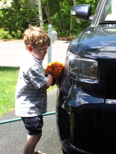 Boy Car Carwash Casual Clothing Childhood Chores Cleaning Cute Helping Leisure Activity Lifestyles Orange Color Outdoors Person Playing Reflections Scrubbing Suburbia Summertime Sunlight Youth Of Today