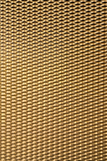 Golden background from sheet metal with pattern Golden Background Gold Griddle Griddle Pan Metal Textured Effect Abstract Backgrounds Pattern Full Frame Textured  No People Close-up Brown Textile Wire Mesh Wire Indoors  Macro Striped Material Design Shape Day Mat Wall - Building Feature Crisscross Wood Grain