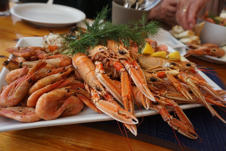 Seafoods Seafoods Close-up Crab Crustacean Dinner Finger Food Food And Drink Freshness Hand Healthy Eating Human Body Part Human Hand Human Limb Indoors  Meal One Person Plate Ready-to-eat Seafood Serving Size Shrimp - Seafood Table Tray Wellbeing