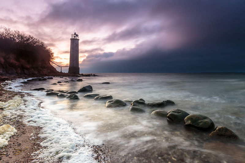 Storm arives just before sunset at a lighthouse on island ruegen. Baltic Sea Leuchtturm Ostsee Storm Beach Beauty In Nature Before The Storm Cloud - Sky Guidance Horizon Over Water Land Lighthouse Linien Nature No People Rock Scenics - Nature Sea Sky Solid Sturm Tower Water