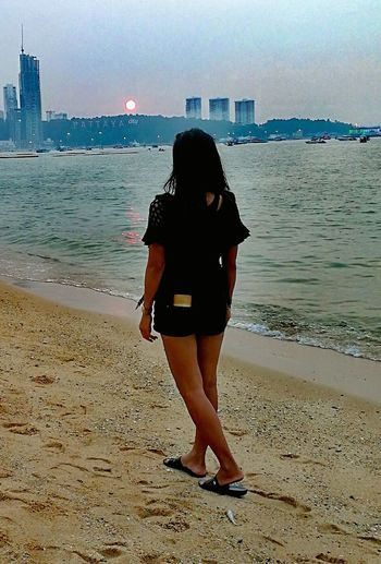 Beach One Person Sea Real People Me Only Women Rear View Sunset Thailand🇹🇭 2017 EyeEm Selects Water Horizon Over Water Beautifull Architecture Trending Now Travel Destinations Be. Ready. Tranquil Scene Beauty Sand Full Length Lifestyles Adults Only Standing EyeEm Ready
