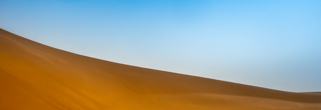Abstract image of the surface of a sloping dune in the Sahara in Sudan Sky Environment Nature Scenics - Nature Day Sunlight Desert No People Copy Space Landscape Land Sand Dune Tranquility Blue Clear Sky Beauty In Nature Sand Tranquil Scene Outdoors Climate Arid Climate