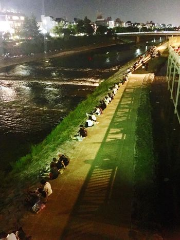 Old school dating along the riverbank Large Group Of People Water River Bank  Dating Spot Real People Grass Dating Japanese Culture