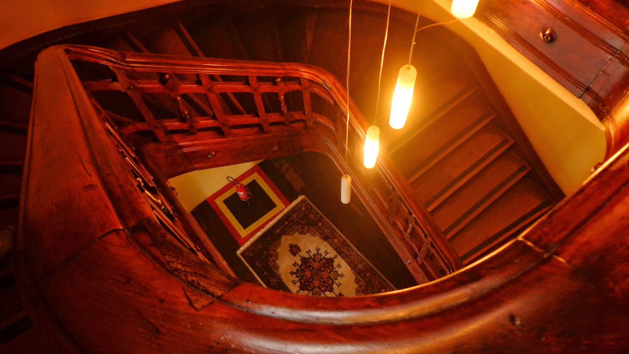 indoors, illuminated, transportation, architecture, built structure, low angle view, metal, no people, mode of transport, orange color, interior, lighting equipment, steps, railing, staircase, ceiling, steps and staircases, old, close-up, tunnel