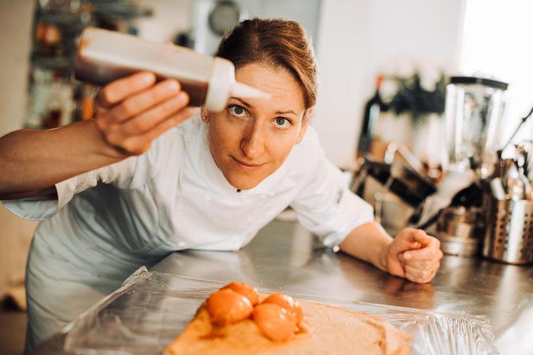 Portrait of woman preparing food at home