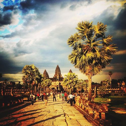 Cambodia trip. 2016. Park Architecture Archeology Architecture_collection Cambodia Angkor Wat IPhone Photography sammer Sky Cloud Large Group Of People Walking Person Cloud - Sky Day Outdoors Walkway Cloudy Tourism Vacations Tranquility Memories