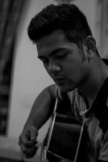 A boy practicing guitar