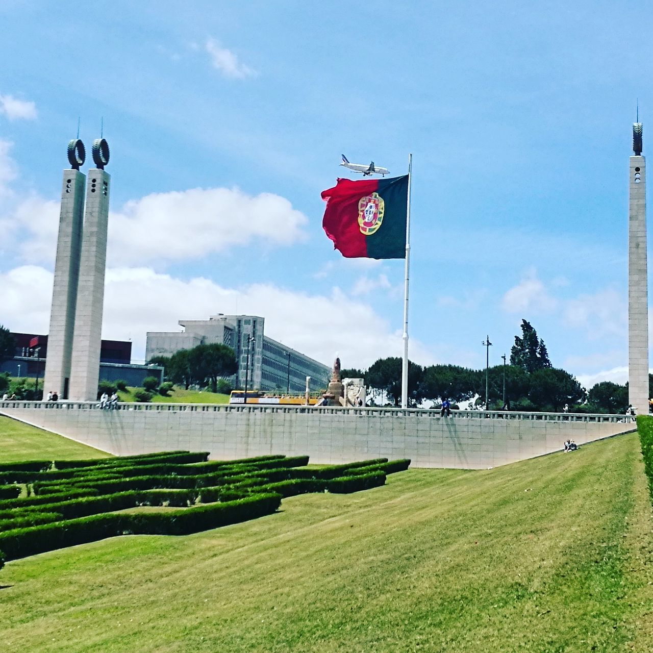 flag, patriotism, architecture, built structure, grass, pride, day, building exterior, sky, history, no people, travel destinations, tree, outdoors, green color, nature