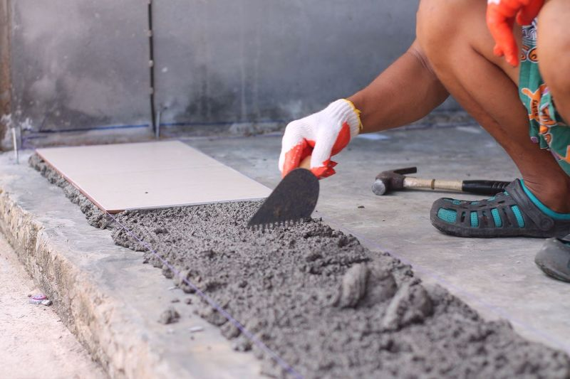Low section of person working on floor