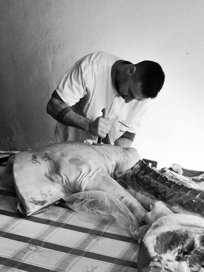 The butcher cut up the pork's carcass