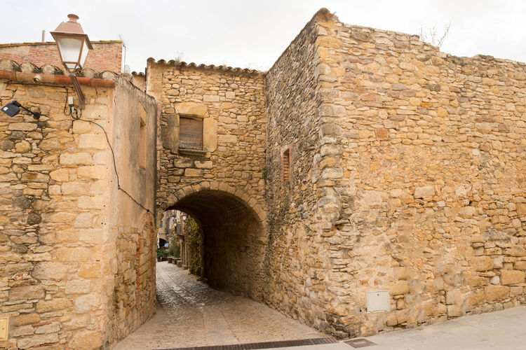 Catalonia Country Rural SPAIN Ancient Arch Architecture Building Exterior Built Structure Day Fort Girón History Medieval No People Old Old Ruin Outdoors Peratallada Sky