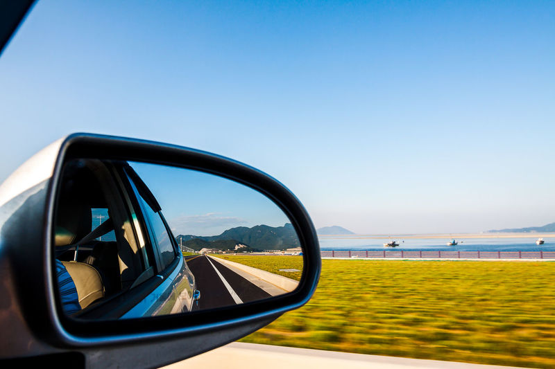 Reflection Of Road On Car Side-View Mirror