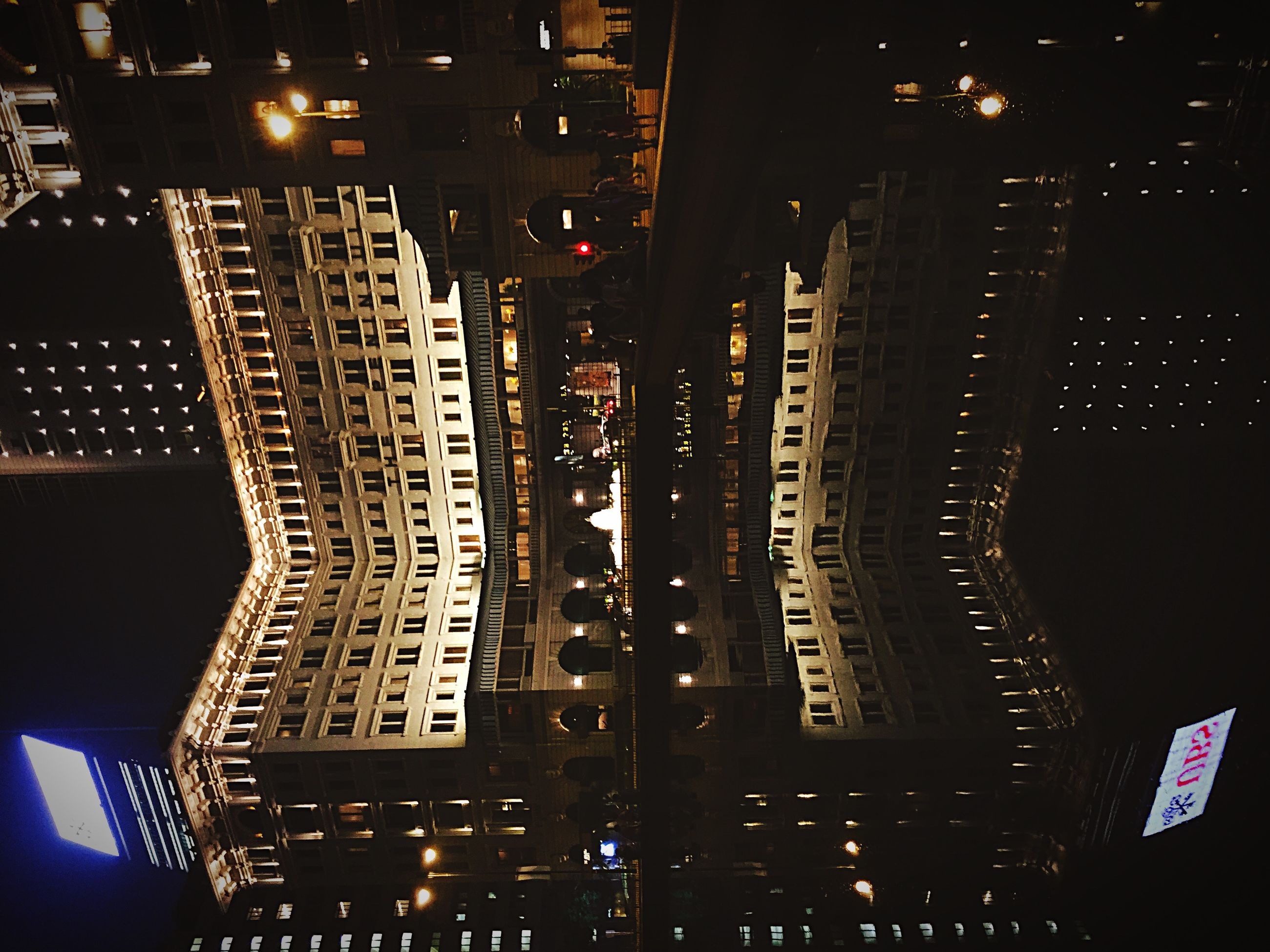 night, illuminated, building exterior, architecture, built structure, city, skyscraper, modern, office building, tall - high, tower, low angle view, building, cityscape, dark, city life, financial district, residential building, no people, outdoors