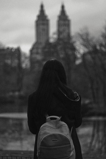 Central Park, 2018 Built Structure Architecture Real People Rear View Focus On Foreground Lifestyles Building Exterior One Person Women Adult Leisure Activity Standing City Day Clothing Building Sky Religion Hood Outdoors Hood - Clothing Warm Clothing Black And White New York Central Park 17.62°