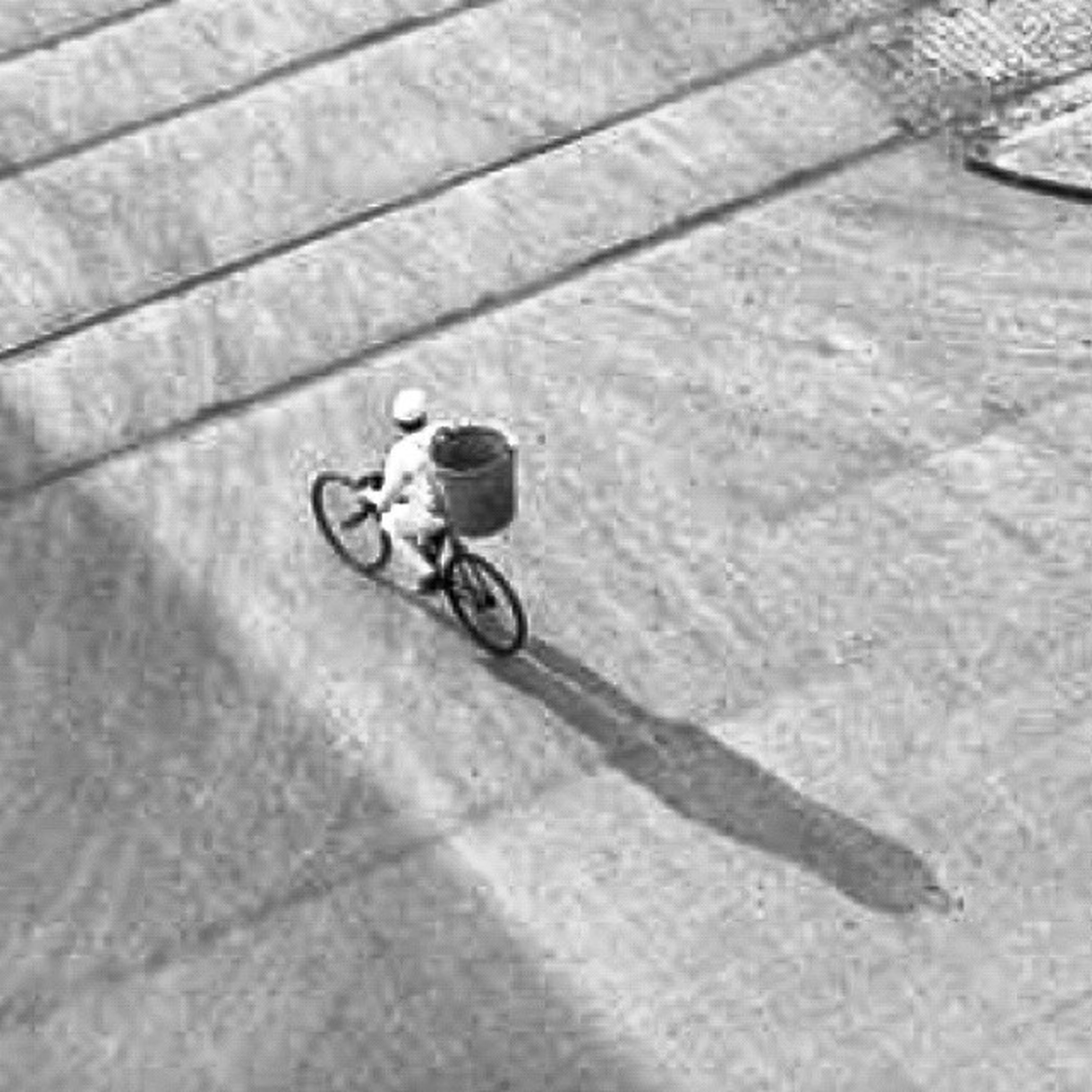 bicycle, transportation, riding, lifestyles, mode of transport, full length, leisure activity, land vehicle, street, men, cycling, shadow, road, on the move, sunlight, walking, high angle view, outdoors