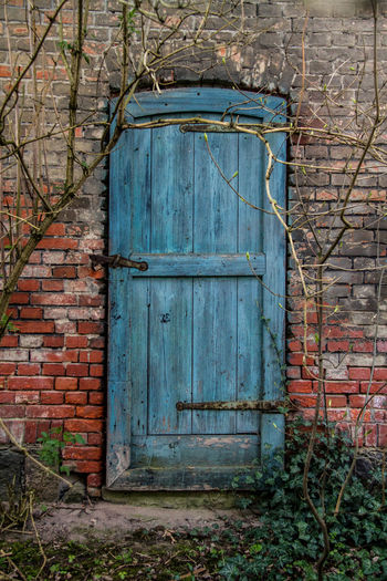 Abandoned Buildings Architecture Brick Wall Building Exterior Built Structure Close-up Closed Day Door Nature No People Outdoors Weathered Wood - Material