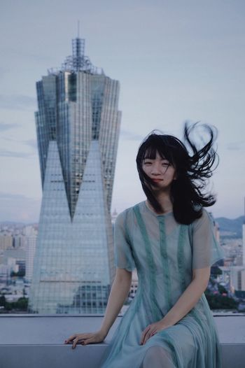 EyeEm Best Shots View Wind Tower Skycraper Portrait Of A Woman Portrait ThatsMe Architecture One Person Built Structure Sitting City Hairstyle Sky Fashion Beautiful Woman Urban Fashion Jungle Summer In The City