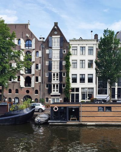 Amsterdam Amsterdam Canal Amsterdamcity Amsterdamse Grachten Architecture Canal Canals Canals And Waterways City City City Life City Life Cityscape Cityscape Cityscapes Day House Houseboat Houseboats In Amsterdam No People Outdoors Sky Summer Travel Destinations Water