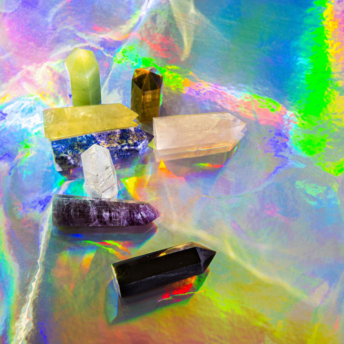 Close-up of digital composite image of rainbow over water