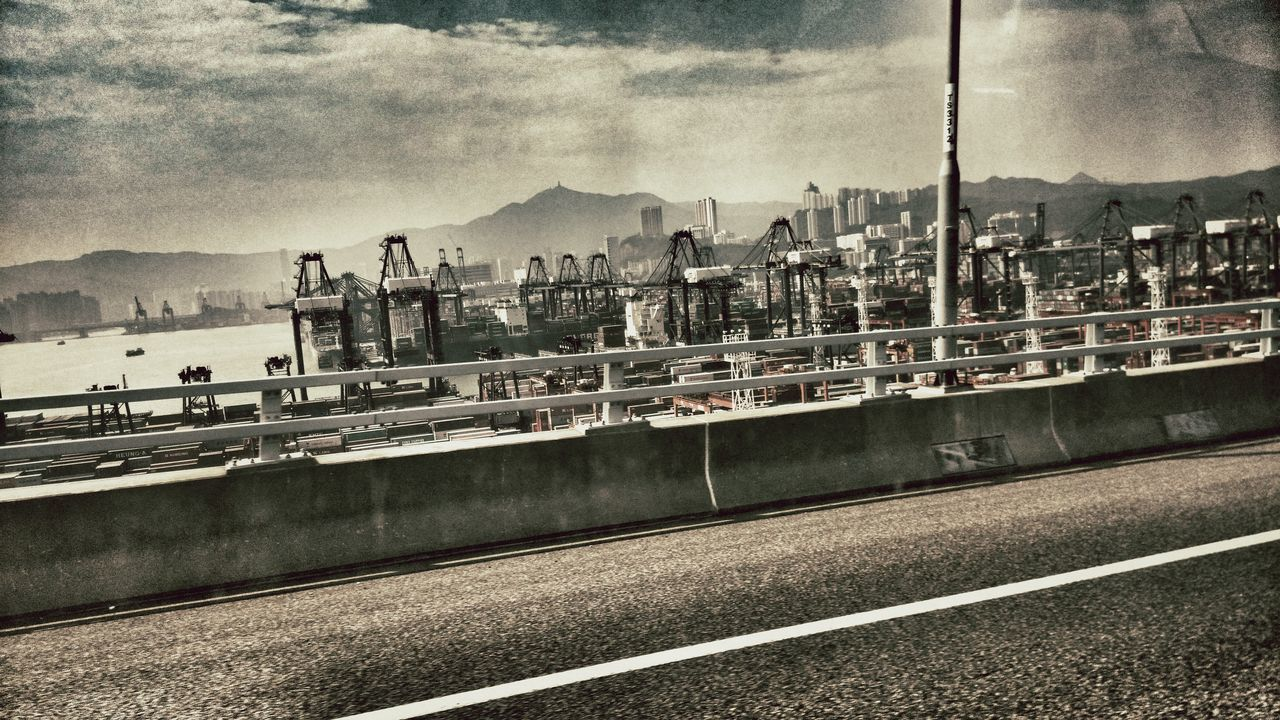 transportation, mountain, sky, road, outdoors, architecture, city, day, no people, built structure, water, cityscape, building exterior