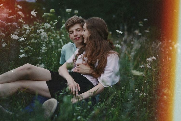 Happy Young Couple Romancing In Park