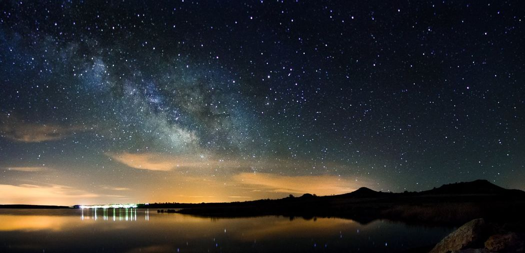 Scenic view of lake against star field